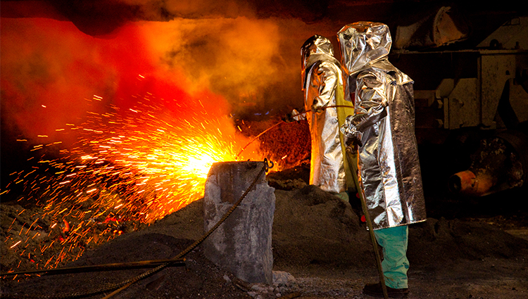 people working at a blast furnace