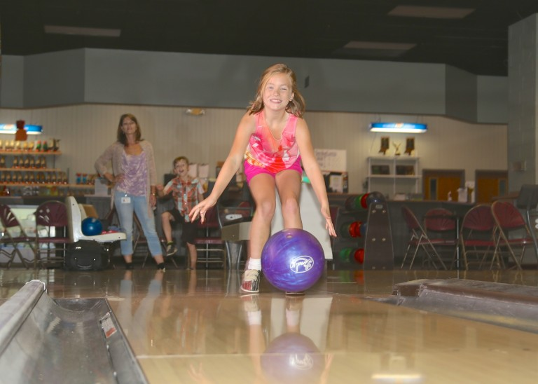 a girl bowling