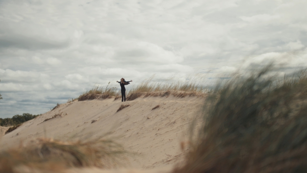a woman on a sand dune