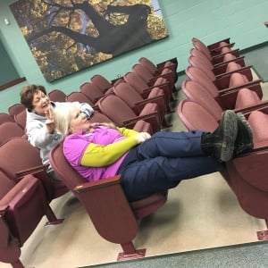 Maureen and Elizabeth get comfy in the theater. Perhaps a little too comfy.