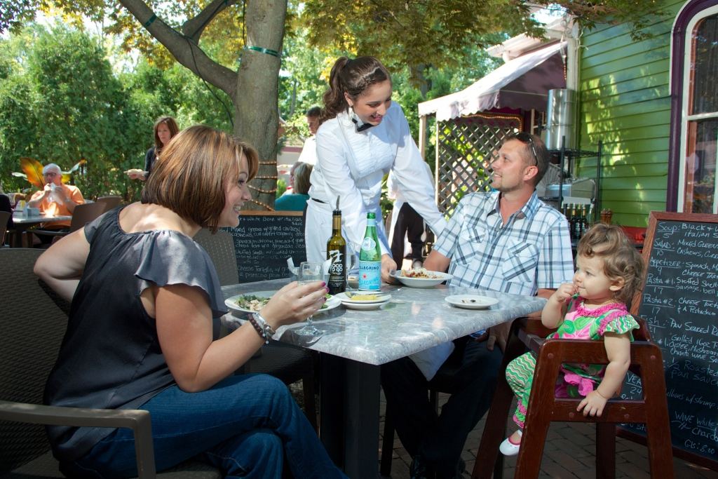 Family eating outdoors at a restaurant
