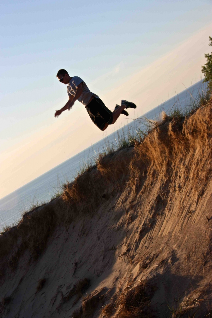 a man jumping in sand