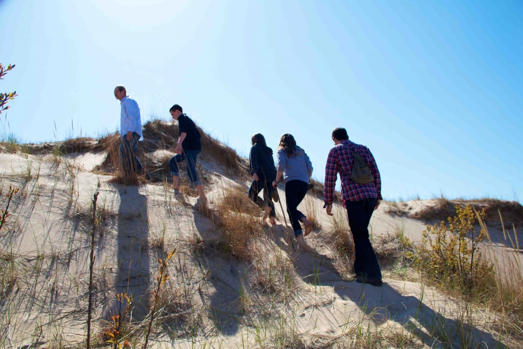 people hiking the dunes