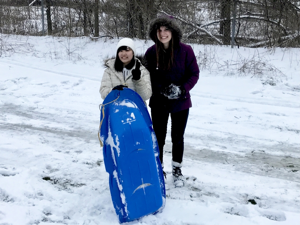 Teens with a sled
