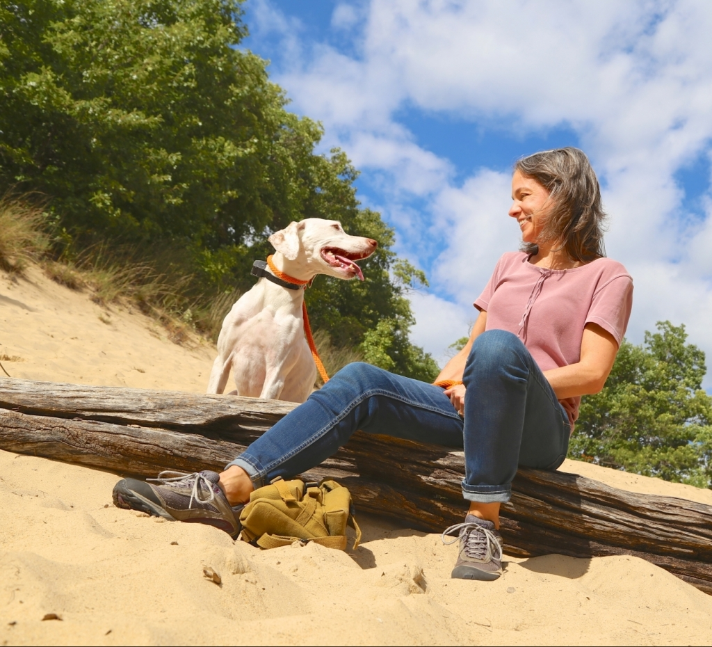 Woman with her dog on the 3 Dune Challenge