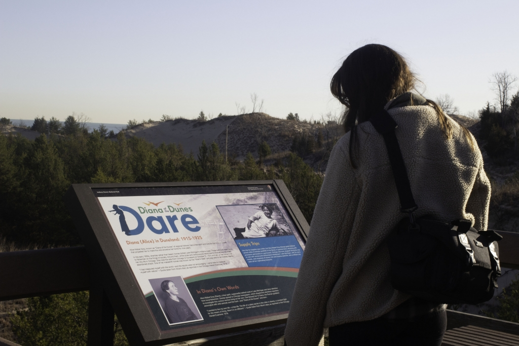 Girl looking at the Diana Dunes Dare sign